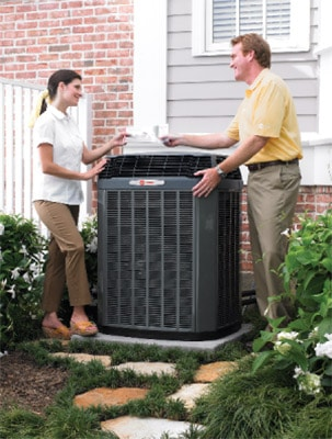 Woman and HVAC dealer outside by A/C unit. 10 best air conditioning brands. Air Plus Heating & Air Conditioning.